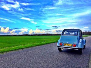 In een lelijke eend op wereldreis door Nederland